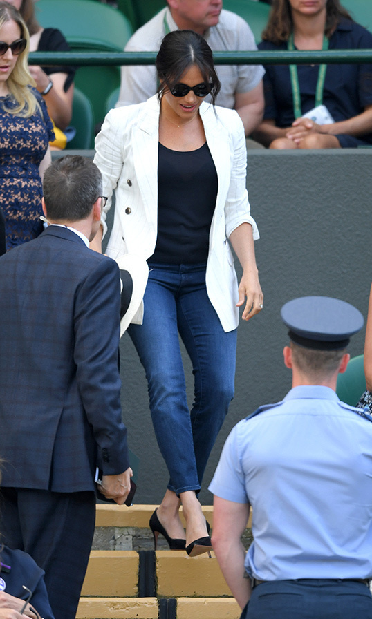 "<a href=""/tags/0/meghan-markle""><strong>Duchess Meghan</strong></a> surprised royal watchers with an outing to Wimbledon on July 4, sided by her Northwestern University friends, <strong>Lindsay Roth</strong> and <strong>Genevieve Hillis</strong>. She looked perfectly casual in Outland Denim 'Harriet' jeans, a black T-shirt and her L'Agence 'Brea' pinestripe blazer. She anchored the look with a pair of black pumps, accessorizing with a Madewell panama hat, Pippa Small Nosheen stuf earrings, a Verse Jewelry 'A' necklace and a Jessica McCormack signature sapphire heart button back ring. Shielding her eyes from the sun were her Finlay London 'Henrietta' sunglasses.