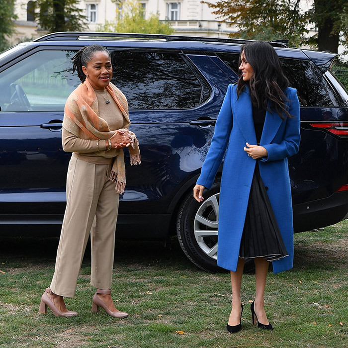 "Just four months after Meghan and Harry exchanged vows, her loving mom was back out again. <a href=""/tags/0/doria-ragland""><strong>Doria</strong></a> joined her daughter and <a href=""/tags/0/prince-harry""><strong>Prince Harry</strong></a> for the launch of a cookbook with recipes from a group of women affected by the Grenfell Tower fire.