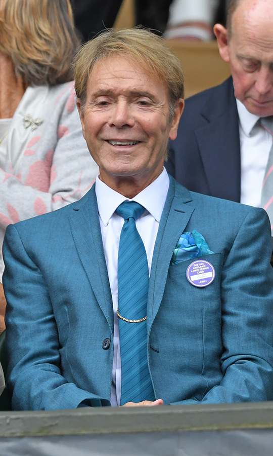 Rock 'n' roll legend <strong>Cliff Richard</strong> was very matchy-matchy as he stepped out to Wimbledon on July 9. He wore a turquoise suit, matching tie and pocket square. 