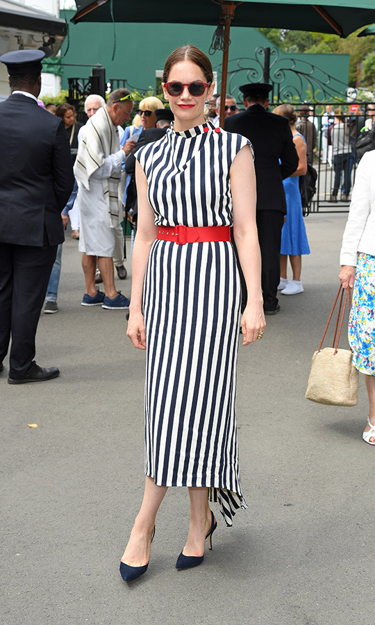 "Former <i>Luther</i> and <i>The Affair</i> star <strong><a href=""/tags/0/ruth-wilson"">Ruth Wilson</a></strong> returned for her second day in a row at Wimbledon on July 9. She looked unbelievable, sporting a black-and-white striped dress with capped sleeves, which she accessorized with a red belt. 