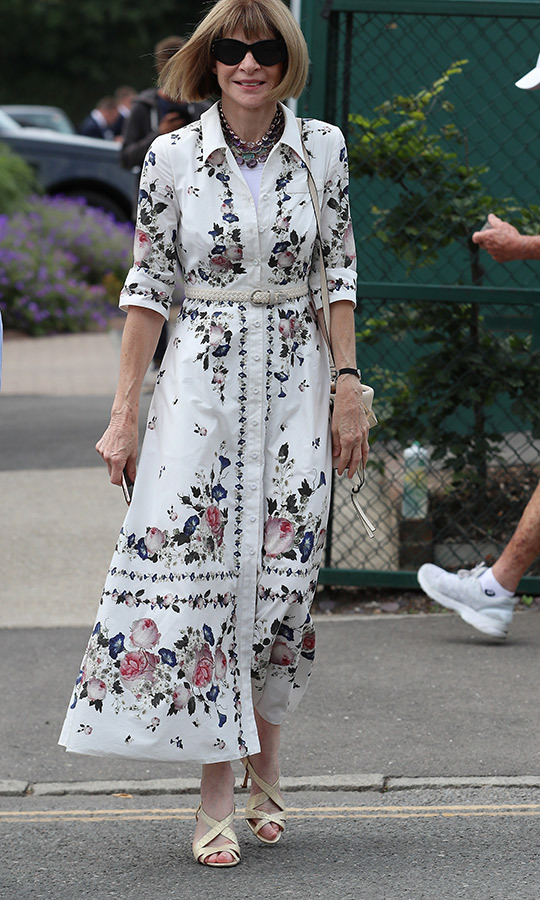 "<strong><a href=""/tags/0/anna-wintour"">Anna Wintour</a></strong> stepped out to Wimbledon looking like the true style maven she is in a gorgeous dress with floral patterns, which she accessorized with a white belt. She wore her trademark sunnies.