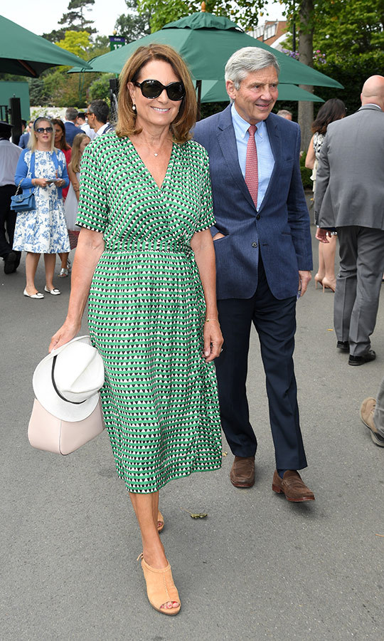 "<strong><a href=""/tags/0/carole-middleton"">Carole Middleton</a></strong> may be taking a page from her daughter's stylebook - or vice versa! <strong><a href=""/tags/0/kate-middleton"">Duchess Kate</a></strong>'s mom stepped out for her second day at <strong><a href=""/tags/0/wimbledon"">Wimbledon</a></strong> in a dress that very much <a href=""https://ca.hellomagazine.com/royalty/gallery/2019070174823/kate-middleton-hampton-court-garden-festival/1/""><strong>resembled one Kate wore</a></strong> just a few days ago at Hampton Court Palace! Her husband Michael Middleton also joined her for the event. Carole accessorized her look with a pair of sunnies and a white hat. She carried a cream handbag.