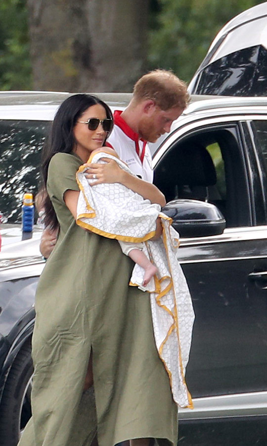 Meghan continued to hold Archie as she and Harry headed back to their car after the match.