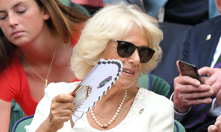 Camilla brought a fan to keep herself cool in the summer heat.
