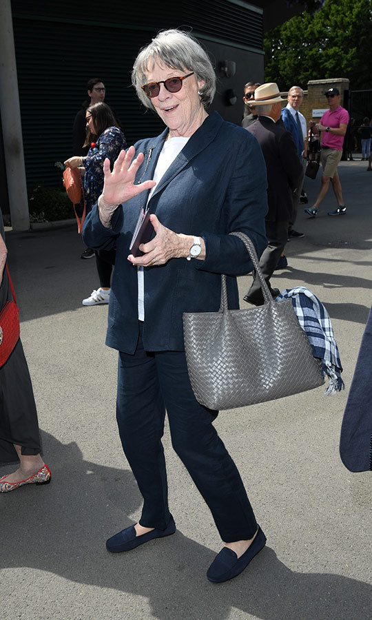 "<strong><a href=""/tags/0/maggie-smith"">Dame Maggie Smith</a></strong> stepped out in simple style that included blue flats, a blue pant suit and a white T-shirt. The <i>Downton Abbey</i> star carried a grey purse. 
