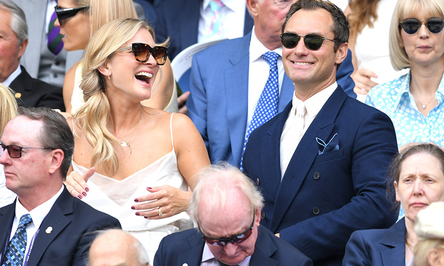 "<strong><a href=""/tags/0/jude-law"">Jude Law</a></strong> and his wife <strong>Phillipa</strong> shared a laugh as they took in a match in the Royal Box. Jude looked incredibly dapper in a navy blue suit with a lighter blue pockt square, a white shirt and white tie. Phillipa looked the picture of summer in a white sundress. 