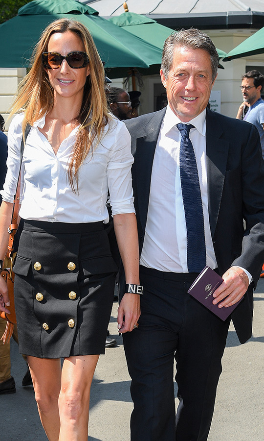 "<strong><a href=""/tags/0/hugh-grant"">Hugh Grant</a></strong> and his wife <strong>Anna</strong> looked happy and stylish as they stepped out for their first Wimbledon appearance. 