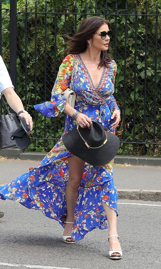 "W is for Wimbledon, but it's also for wow! <strong><a href=""/tags/0/catherine-zeta-jones"">Catherine Zeta-Jones</a></strong> looked unbelievable at the courts in this floral dress with a belted tie around the waist, which she paired with white platform heels and a massive black sun hat.