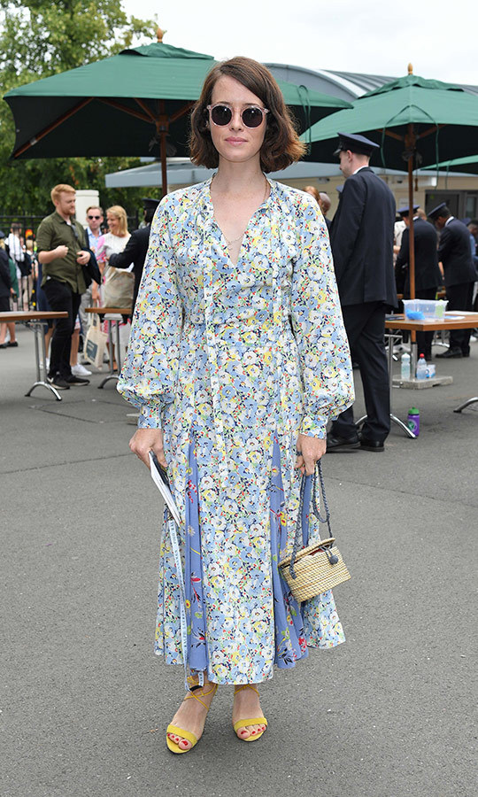 "<strong><a href=""/tags/0/claire-foy"">Claire Foy</a></strong> returned for her second and final day at Wimbledon, wearing a floral dress with yellow heels.