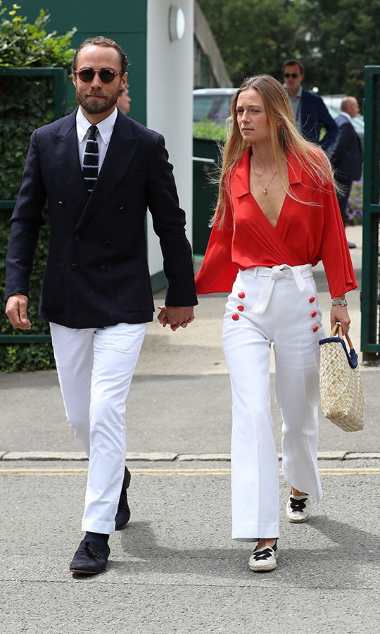 "<strong><a href=""/tags/0/james-middleton"">James Middleton</a></strong> and his girlfriend <strong>Alizee Thevenet</strong> looked very fashion-forward when they arrived at Wimbledon on July 14! James looked quite naval in his blue jaket, white pants, white shirt and striped tie. Alizee chose a unique look with a red blouse, white pants with red buttons up the sides, a white belt and black-and-white flats. 