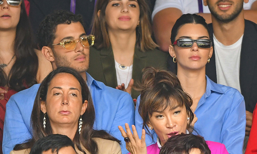 "Even <strong><a href=""/tags/0/kendall-jenner"">Kendall Jenner</a></strong> was at the Wimbledon men's singles final on July 14! If you're wondering who the mystery man twinning next to her is, his name is <strong>Fai Khadra</strong>.