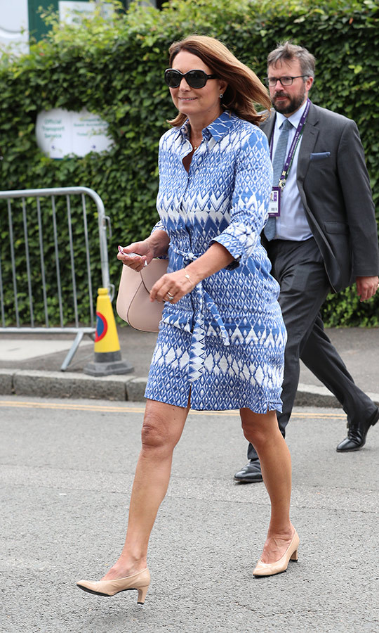 "<strong><a href=""/tags/0/carole-middleton"">Carole Middleton</a></strong> attended July 14's events with her daughter, and looked amazing in a blue and white shirt dress by <Strong>Jaeger</strong>.