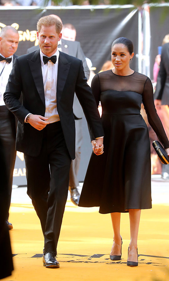 Harry and Meghan looked so glam at the event! This was their red carpet debut as a married couple, and Meghan's first red carpet event as a royal. Meghan looked stunning in a black Jason Wu dress with sheer sleeves. She wore Aquazzura heels and carried a Gucci clutch. 