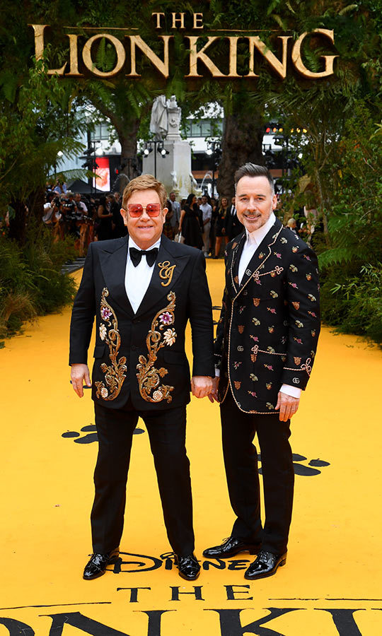 Elton and David looked like the perfect pair on the red carpet! The singer/songwriter wore a suit with a jacket that featured floral detailing and his name embroidered on the left lapel. David's jacket also featured some intricate floral detail. 