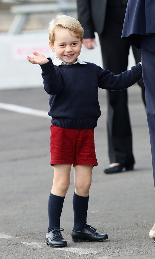 What a sweetheart! George waved goodbye as his family left Victoria on the last day of their Canada tour.