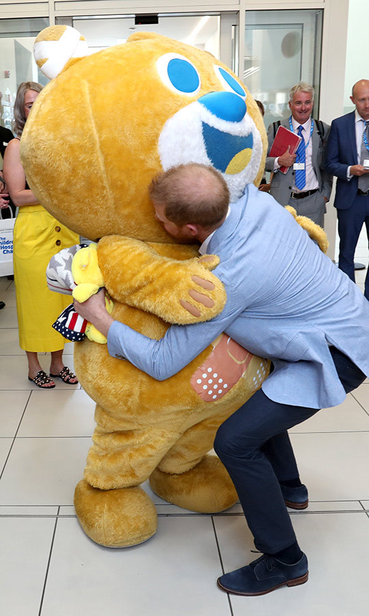 Harry even hugged Theo the Bear, the hospital mascot! And he got a surprise about who was inside - nurse <strong>Julie Austin</strong>, who he found out, had met his mom when she was there in 1989! 