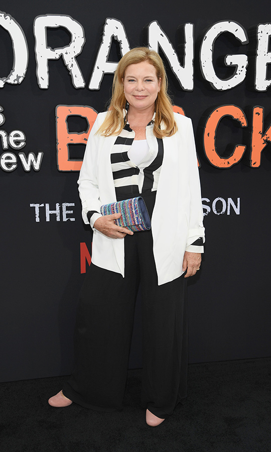 <strong>Catherine Curtin</strong> (correctional officer Wanda Bell) chose a chic black-and-white ensemble with a striped vest and white blazer. She accessorized with a rainbow clutch to give it all a bit of colour.