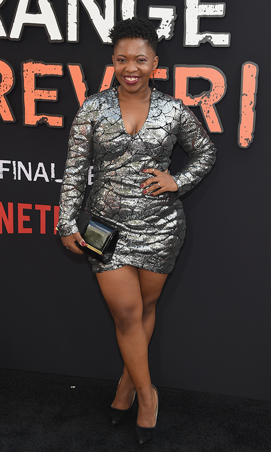 <strong>Phumzile Sitole</strong> (Akers) opted for a slick shiny grey dress with black pumps.