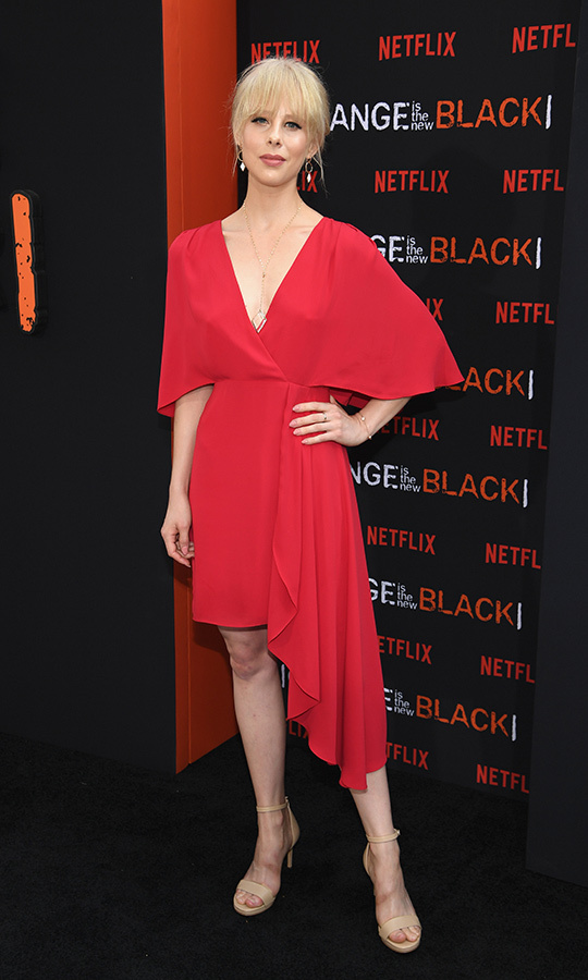 <strong>Christina Toth</strong> (Annalisa Damiva) chose a red v-necked dress with flared shoulders and an uneven skirt cut to give her a very unique and edgy look. 