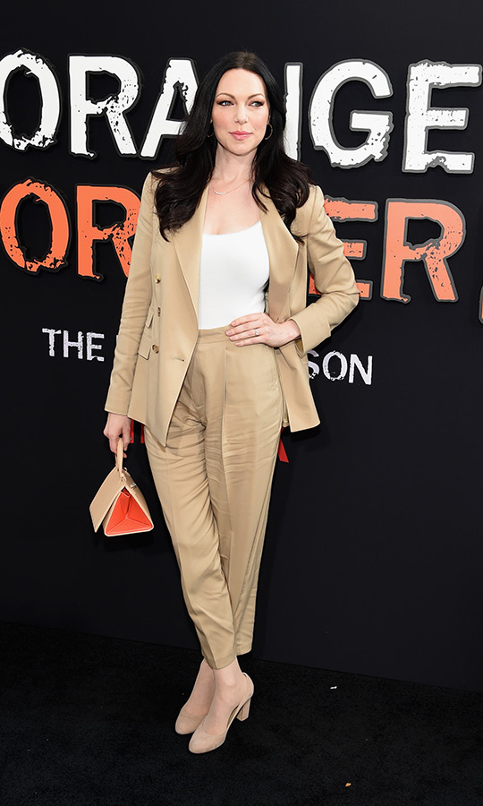 "<strong><a href=""/tags/0/laura-prepon"">Laura Prepon</a></strong> (Alex Vause) chose a tan suit that looks as red carpet ready as it does boardroom ready. She accessorized with a cute triangular purse.