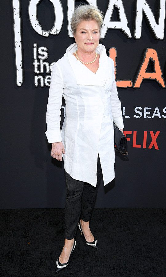 "<strong>Kate Mulgrew</strong> (Galina ""Red"" Reznikov) also opted for black and white, wearing a chic white shirt-dress, black pants and black-and-white heels. She accessorized with a pearl necklace and a black clutch. 