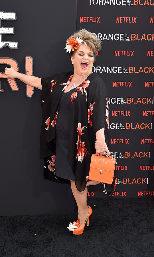 <strong>Lin Tucci</strong> (Anita DeMarco) also took the show name literally, wearing a blakc dress, black wrap with orange floral patterns, orange shoes complete with floral accents and carried an orange purse.