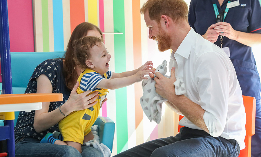 "So sweet! <strong><a href=""/tags/0/prince-harry"">Prince Harry</a></strong> stepped out to Sheffield Children's Hospital in July 2019 and shared a wonderful moment with little <strong>Noah Nicholson</strong> as he played tug-of-war with him over his stuffed giraffe. 