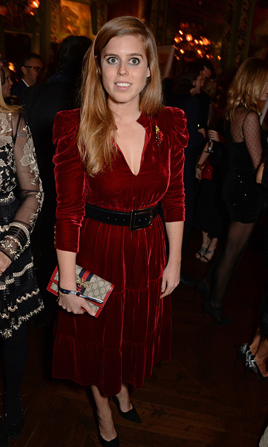 "<strong><a href=""/tags/0/princess-beatrice"">Beatrice</a></strong> looked stunning in this red velvet dress by <strong>Pinko</strong> as she attended the Annabel's Art Auction fundraiser in aid of Teenage Cancer Trust & Teen Cancer America in November 2018. She carried her extremely chic bee-embroidered (get it?) clutch by <strong><a href=""/tags/0/gucci"">Gucci</a></strong>.