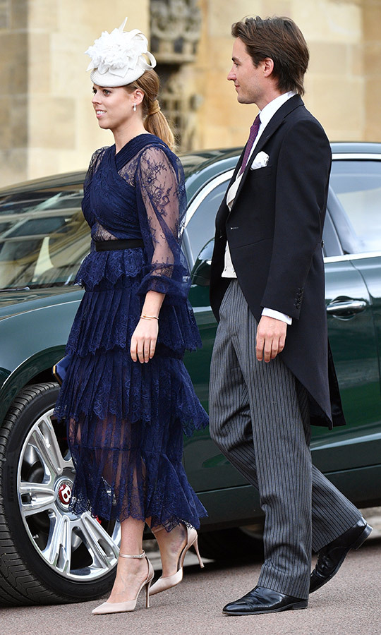 "For <strong><a href=""/tags/0/lady-gabriella-windsor"">Lady Gabriella Windsor</a></strong>'s wedding in May, <a href=""/tags/0/princess-beatrice"">Princess Beatrice</a></strong> chose a navy sheer and lace <Strong>Self-Portrait</strong> dress, which she paired with nude pumps and a white hat with floral accents. Boyfriend <strong><A href=""/tags/0/edoardo-mapelli-mozzi"">Edoardo Mapelli Mozzi</a></strong> looked handsome in a black jacket, grey pinstriped pants, white shirt and purple tie.