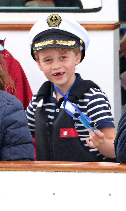 "OMG, we can't! How adorable did <strong><a href=""/tags/0/prince-george"">Prince George</a></strong> look at the King's Cup Regatta? He's the true captain! The six-year-old, who looks like he's lost some more teeth recently, was the cutest in a blue-and-white-striped Breton top with a captain's hat on his head! Here's hoping the Tooth Fairy leaves a gift certificate for sailing lessons under his pillow!