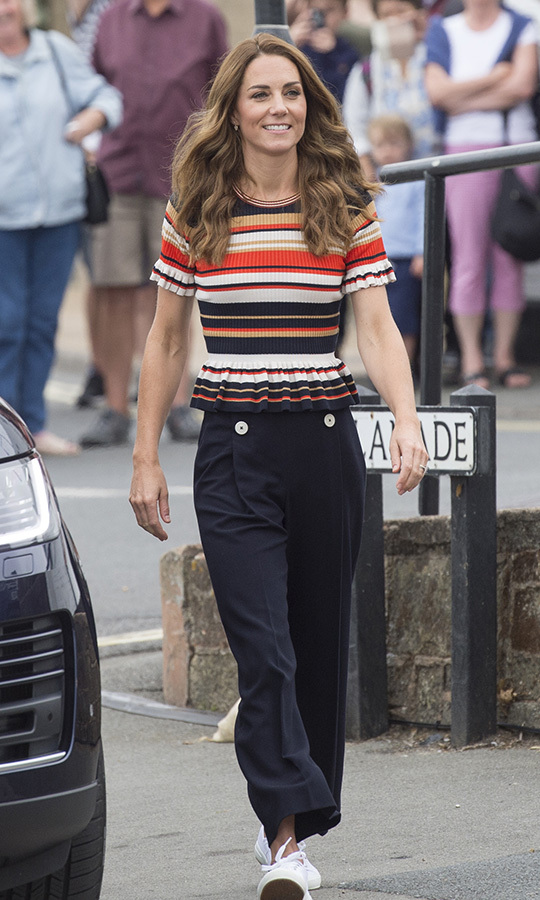 Kate looked thrilled as she arrived at the Esplanade in Cowes before the regatta. She looked pretty dressed for the occasion, too, sporting navy nautical pants, a multicoloured striped shirt and her favourite white sneakers.