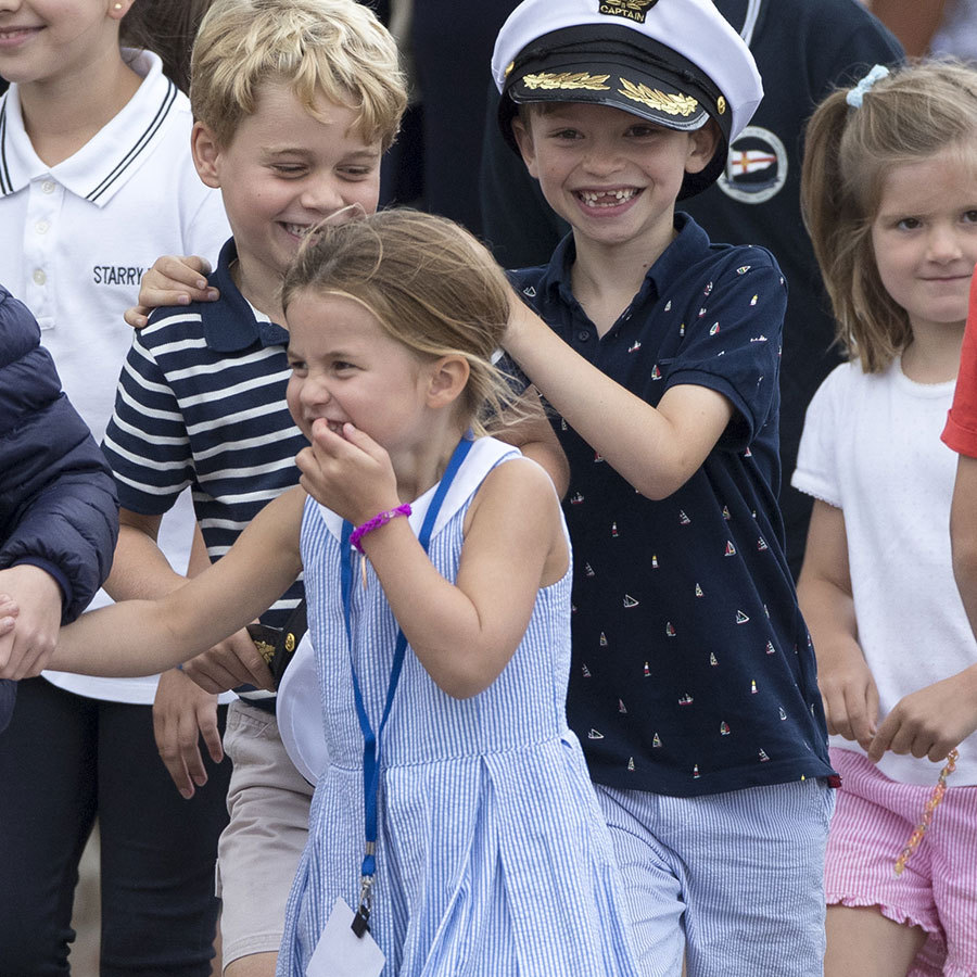 "<strong><a href=""/tags/0/prince-george"">Prince George</a></strong> and <strong><a href=""/tags/0/princess-charlotte"">Princess Charlotte</a></strong> really looked like they had a blast! They shared a funny moment with a friend during the day's festivities.