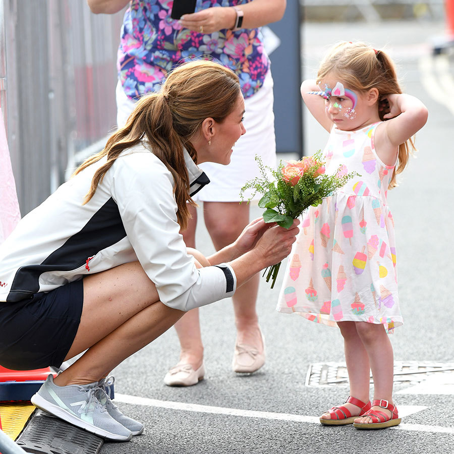 "<strong><a href=""/tags/0/kate-middleton"">Kate</a></strong> was thrilled to be given a bouquet by an adorable little girl who was dressed as a unicorn on her way over to the awards!