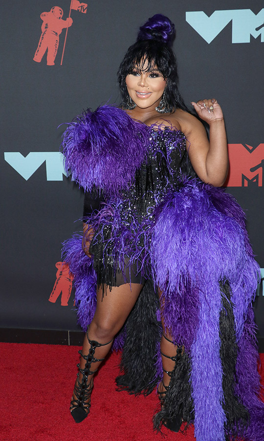 "<strong><a href=""/tags/0/lil-kim"">Lil Kim</a></strong> rocked a very unique purple and black look.