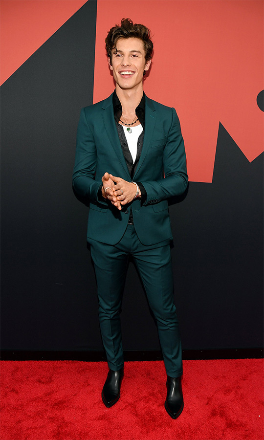 "Canada's own <strong><a href=""/tags/0/shawn-mendes"">Shawn Mendes</strong></a> looked confident and happy in a green suit.