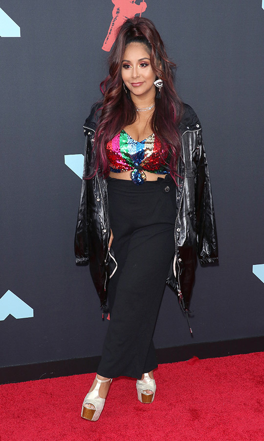 MTV veteran <Strong>Snooki</strong> rocked some eclectic style on the red carpet, pairing wedges with a black skirt, rainbow sequined bikini and black jacket.