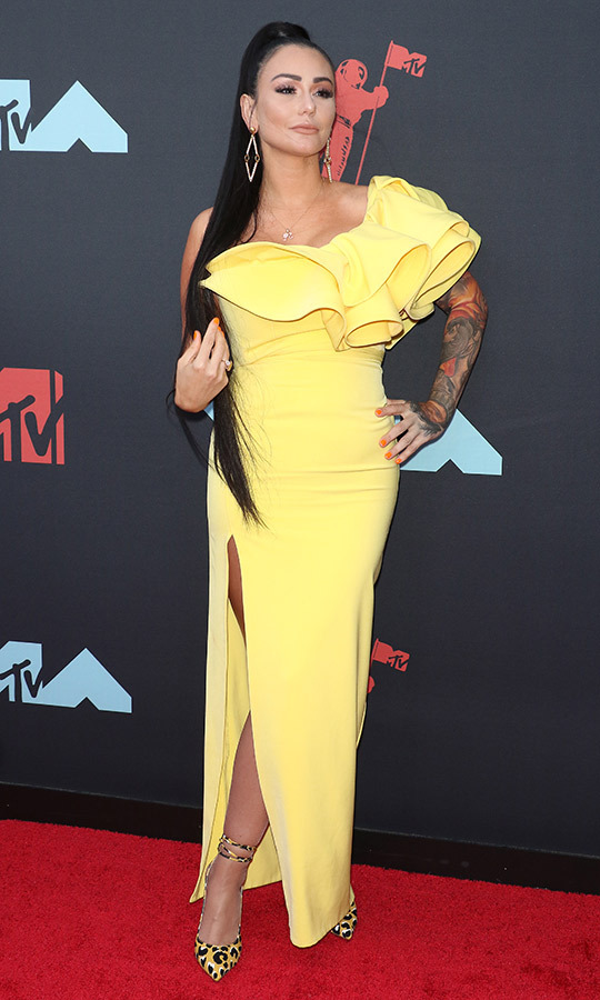 "Her former <i>Jersey Shore</i> co-star <strong><a href=""/tags/0/jwoww"">Jwoww</a></strong> wore a one-shoulder yellow dress with a ruffle and leopard-print heels.