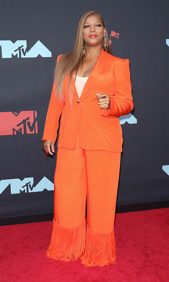 "<strong><a href=""/tags/0/queen-latifah"">Queen Latifah</a></strong> stunned in an orange suit which had pants complete with tassles. The perfect look for one of the queens of '90s hip-hop.