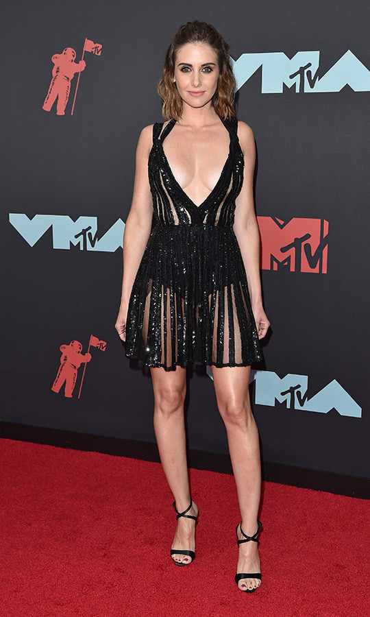 <strong>Alison Brie</strong> chose a shiny black dress with sheer cutouts.