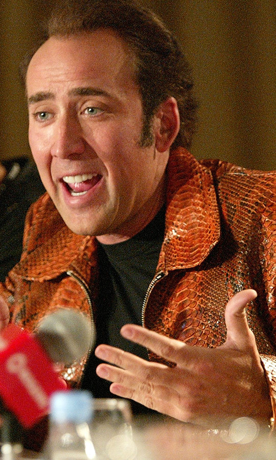 "Look at that jacket! Forget snake eyes, talk about snake skin! <strong><a href=""/tags/0/nicolas-cage"">Nicolas Cage</a></strong> looked like he had a blast promoting <i>Matchstick Men</i> in at <strong><a href=""/tags/0/tiff"">TIFF</a></strong> 2003. 