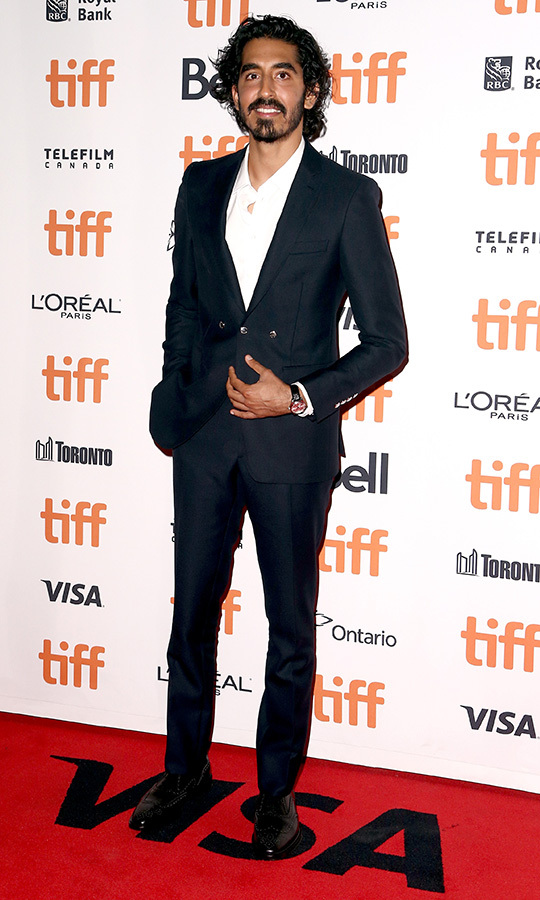 "<strong><a href=""/tags/0/dev-patel"">Dev Patel</a></strong> looked dapper in a navy blue suit and white shirt as he attended the world premiere of <i>The Personal History of David Copperfield</i> and helped kick off <strong><a href=""/tags/0/tiff"">TIFF</a></strong> 2019! 