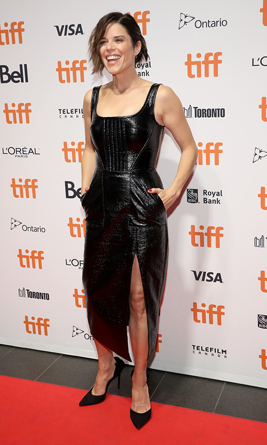 "We're screaming for <Strong><a href=""/tags/0/neve-campbell"">Neve Campbell</a></strong>! The Canadian star looked completely stunning in a black leather dress on the red carpet for <i>Castle in the Ground</i> at <Strong><a href=""/tags/0/tiff"">TIFF</a></strong> on Sept. 5! 