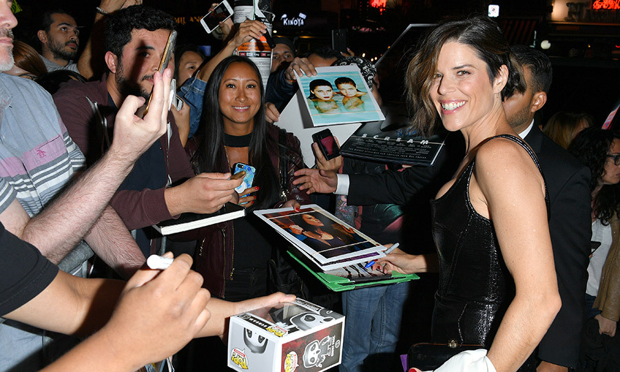 "<strong><a href=""/tags/0/neve-campbell"">Neve Campbell</a></strong> looked so thrilled to see her fans as she hit the screening of <i>Castle in the Ground</i> on Sept. 5! 