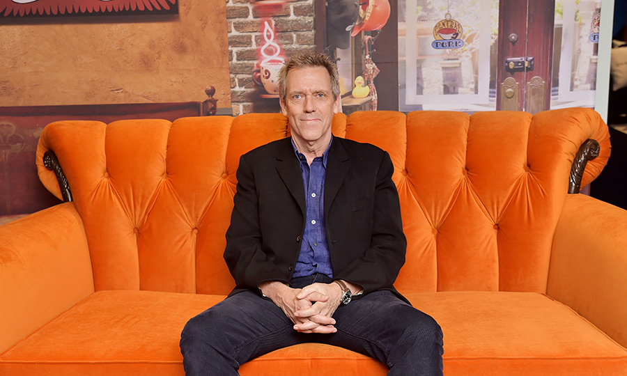 "<strong><a href=""/tags/0/hugh-laurie"">Hugh</a></strong> also took some time to chill out at AT&T On Location at Hotel Le Germain (made to look like Central Perk from <i>Friends</i>) on Sept. 6. 