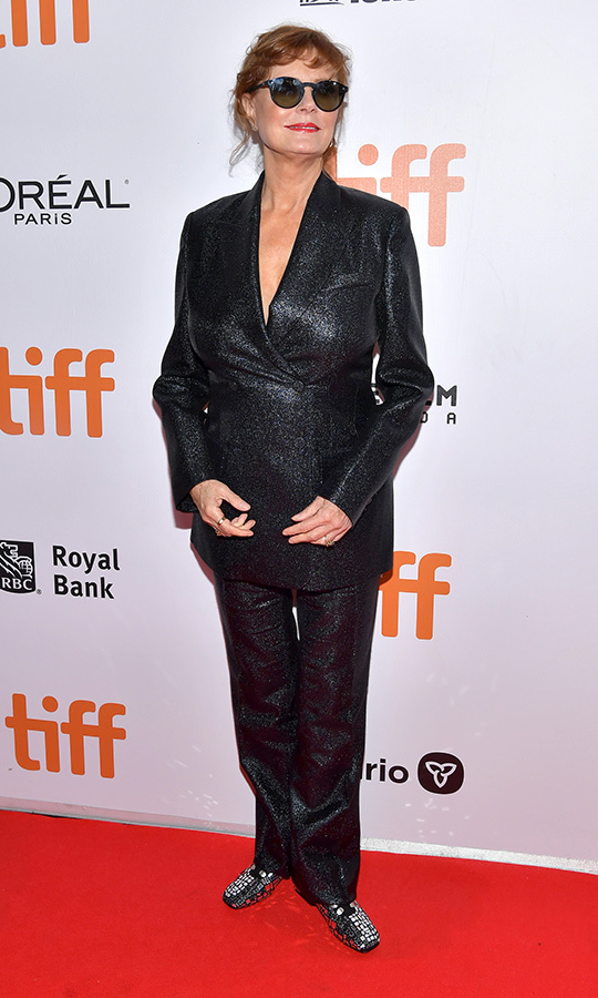 "Is this the most glam pantsuit of all time? We think so! <strong><a href=""/tags/0/susan-sarandon"">Susan Sarandon</a></strong> showed up to the <i>Blackbird</i> world premiere in a glam outfit by Cavalli that she told <i>Hello! Canada</i>'s parties correspondent <a href=""/tags/0/jen-kirsch""><strong>Jen Kirsch</a></strong> she's had for years. And on her feet... shiny disco ball shoes! It was all so bright she had to wear sunglasses at night! 
