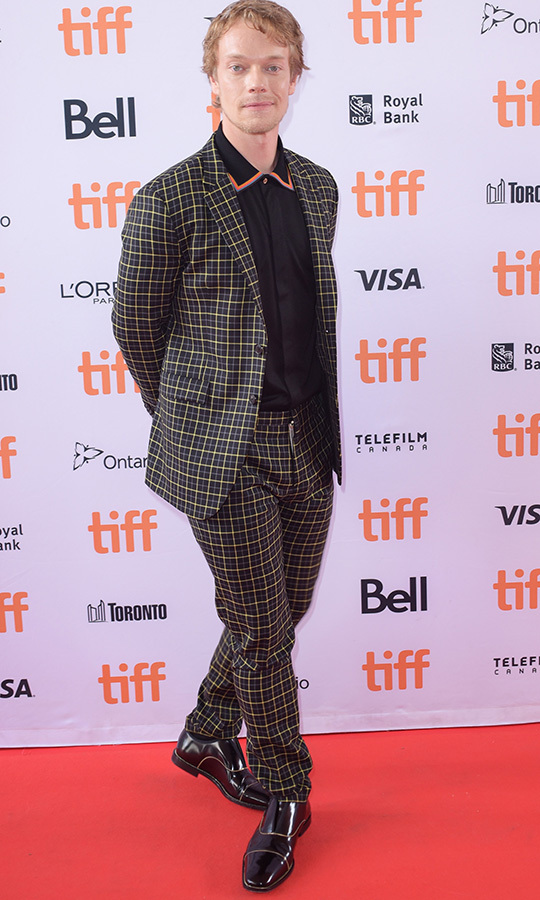 "<Strong><a href=""/tags/0/alfie-allen"">Alfie Allen</a></strong> (he's <strong><a href=""/tags/0/lily-allen"">Lily Allen</a></strong>'s brother, if you're keeping track) chose a very playful suit and polo shirt for the <i>How to Build a Girl</i> premiere on Sept. 7!