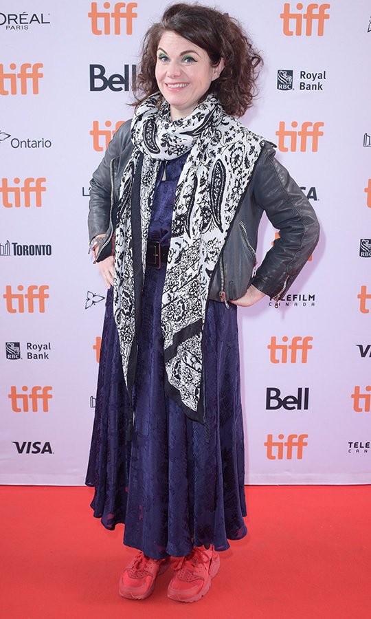 "Author <strong><a href=""/tags/0/caitlin-moran"">Caitlin Moran</a></strong>, who wrote the book <i>How to Build a Girl</i>, on which the film is based, looked like a boho rock star in a very unique and colourful red carpet outfit for the film's premiere!