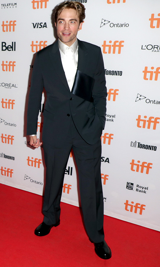 "<Strong><a href=""/tags/0/robert-pattinson"">Robert Pattinson</a></strong> looked slick in his suit on the red carpet for <i>The Lighthouse</i>!