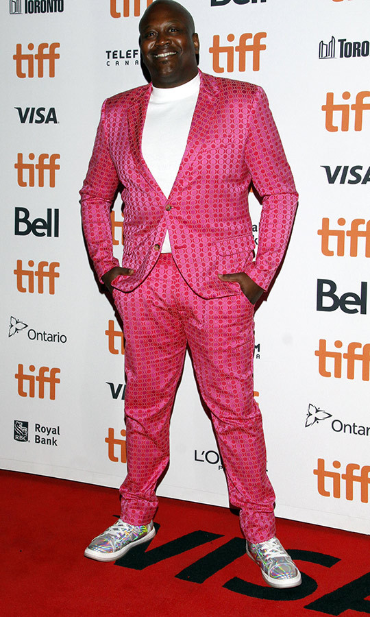 "<strong><a href=""/tags/0/tituss-burgess"">Tituss Burgess</strong></a> wore a textured pink suit with incredible silver sneakers on the <i>Dolemite is My Name</i> red carpet on Sept. 7.