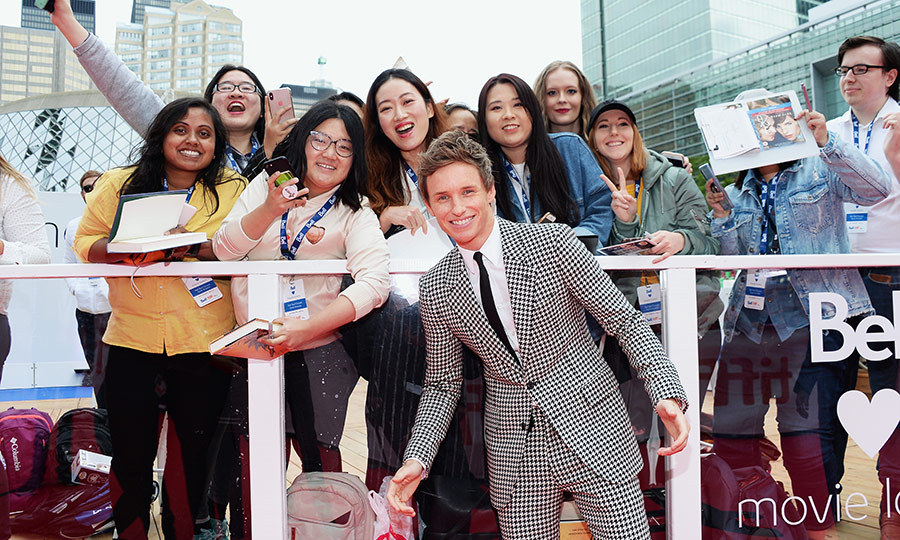 "<strong><a href=""/tags/0/eddie-redmayne"">Eddie Redmayne</a></strong> posed with some fans outside the premiere of <I>The Aeronauts</i> on Sept. 8. 